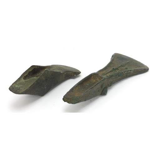 171 - Two antique patinated bronze axe heads, the largest 16cm in length