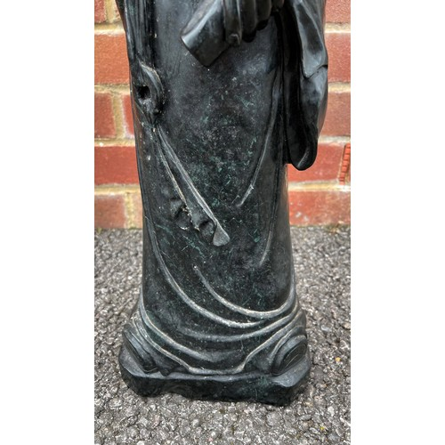 50 - Large Chinese carved green/black stone figure of a standing figure holding a scroll, 69cm high
