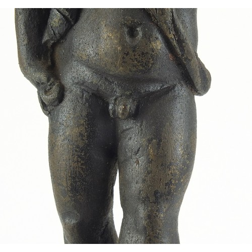 218 - Antique cast metal figure of Putti raised on a marble column base, possibly Greek or Cypriot, 30cm h...
