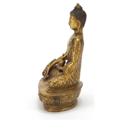 25 - Chino Tibetan gilt bronze figure of seated buddha, 13cm high