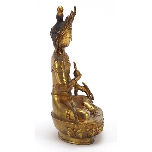 52 - Chino Tibetan gilt bronze figure of seated buddha, 20cm high