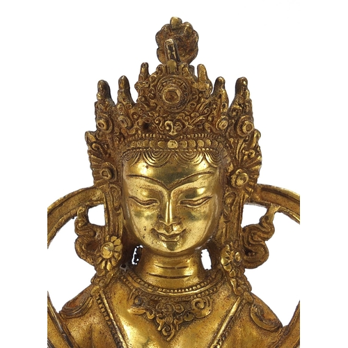 85 - Chino Tibetan gilt bronze figure of buddha, 22cm high