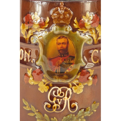 38 - Royal Doulton tankard with a silver collar commemorating George V coronation, 12cm high