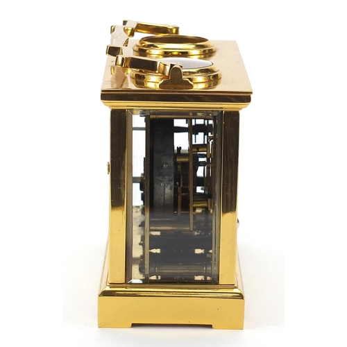 90 - Brass cased travelling timepiece with barometer, clock, thermometer and compass, the barometer and c...