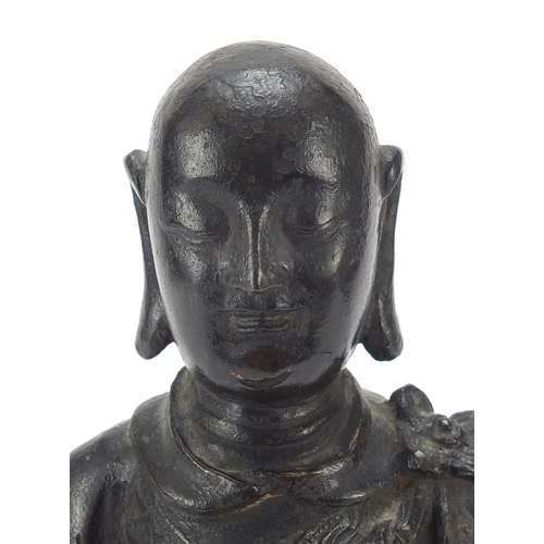 7 - Chinese patinated bronze figure of a standing monk, 24.5cm high