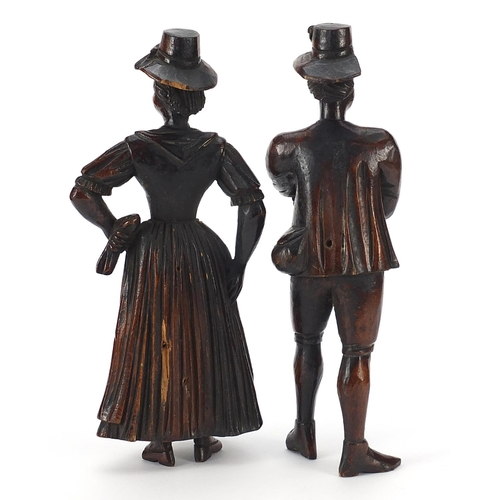 13 - Pair of antique continental wood carvings of peasants in 18th century dress, the largest 22cm high
