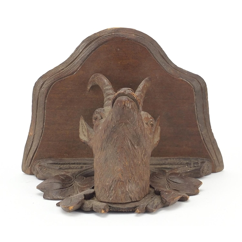 16 - Black Forest carved wall bracket in the form of a goat's head, 11cm high