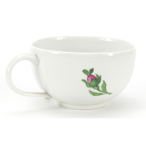 44 - Meissen, 19th century porcelain cup and saucer hand painted with flowers, the saucer 14cm in diamete...