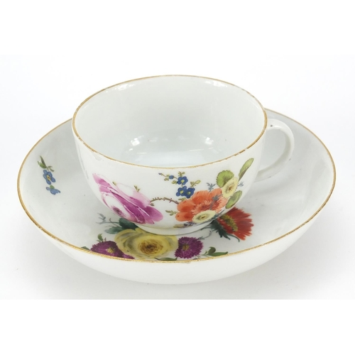 46 - Meissen, 19th century porcelain cup and saucer hand painted with flowers, the saucer 13.5cm in diame...