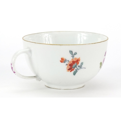 45 - Meissen, 19th century porcelain cup and saucer hand painted with flowers, the saucer 13.5cm in diame...