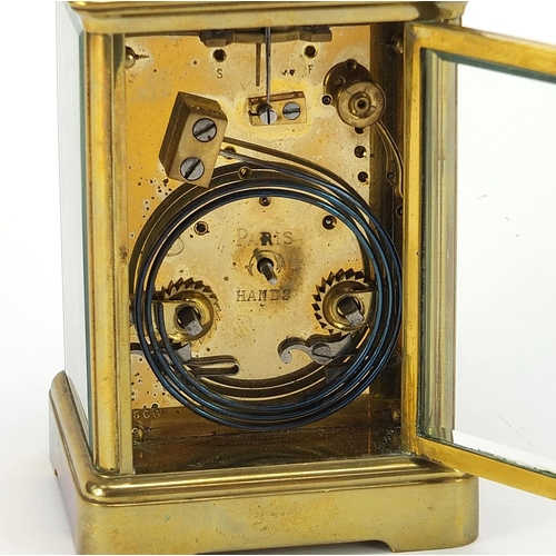 89 - Large French brass cased repeating carriage clock striking on a gong with enamel dial having Roman a...