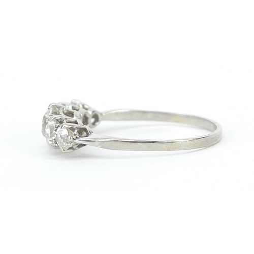 1596 - Unmarked white metal graduated diamond five stone ring, the central diamond approximately 4.5mm in d...