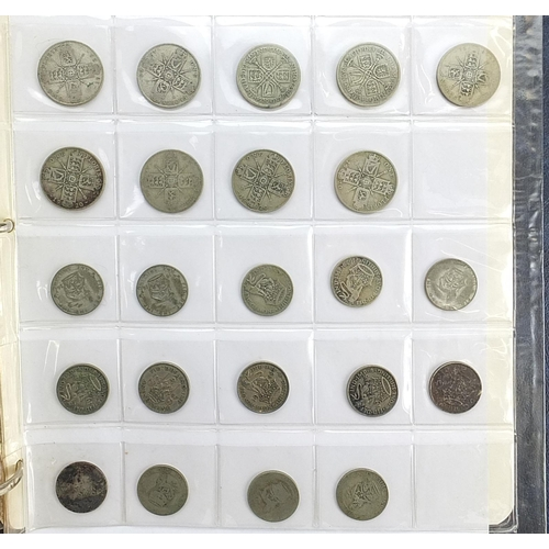285 - British banknotes and coins housed in an album, some pre decimal, including George V 1935 silver Roc...
