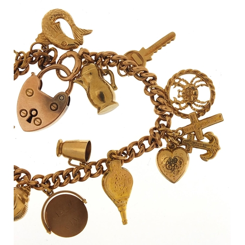 1585 - 9ct gold charm bracelet with a selection of mostly 9ct gold charms including faith, hope and charity...