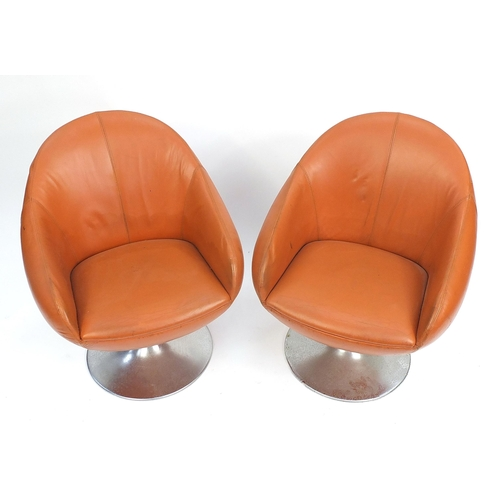 1451 - Pair of vintage egg type tub chairs, signs of paper labels to the underside, each 78cm high
