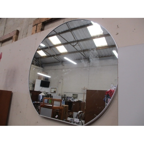 Large round wall mirror with thin silver coloured frame for Thin wall mirror