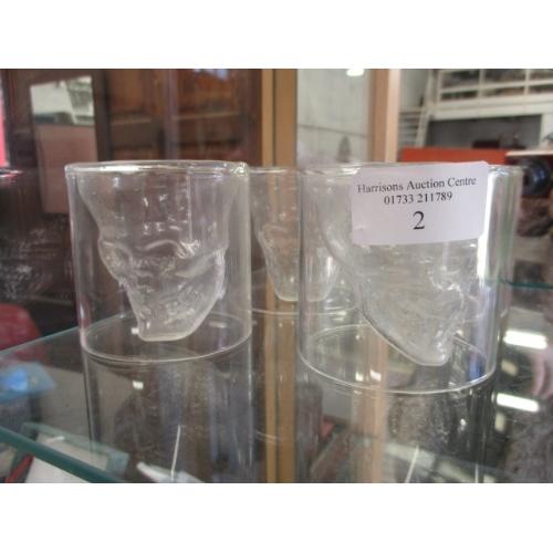 2 - 4 CLEAR UNUSUAL SKULL SHAPED GLASSES...