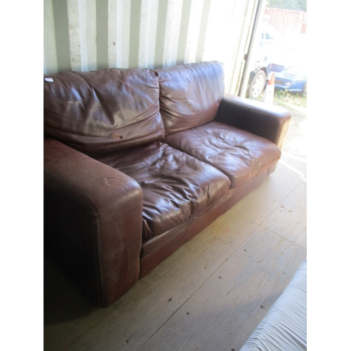 85 - BROWN LEATHER SOFA...
