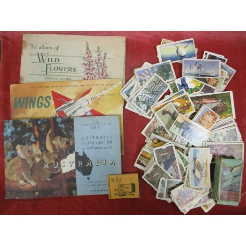 40 - THREE ALBUMS OF TEA CARDS AND SOME LOOSE TEA CARDS AND 3 BEATRIX POTTER BOOKS...