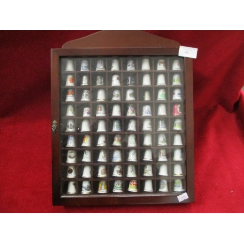 63 - SMALL DISPLAY CASE OF 64  THIMBLES...