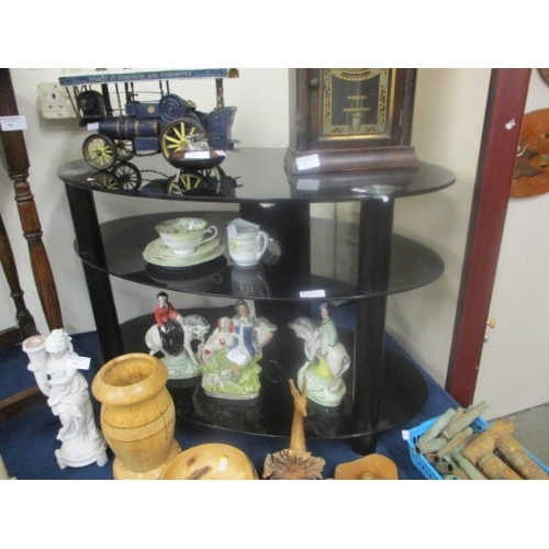 62 - 3 TIER BLACK GLASS OVAL TV STAND...