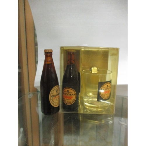 6 - MINIATURE BOTTLE OF GUINNESS AND A MINIATURE GUINNESS  GLASS, BOXED PLUS ANOTHER MINIATURE BOTTLE OF...