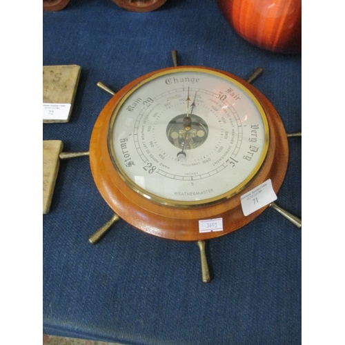 71 - BAROMETER IN THE STYLE OF A SHIPS WHEEL...