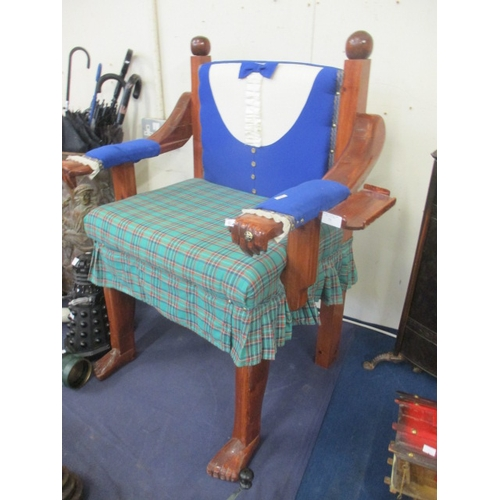 75 - A UNIQUE PINE CHAIR IN THE DESIGN OF TRADITIONAL SCOTTISH DRESS WITH CARVED HANDS AND FEET...