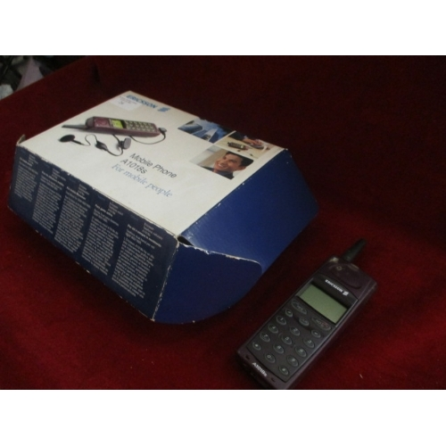 24 - ERICSSON  MOBILE PHONE WITH CHARGER AND BOX...
