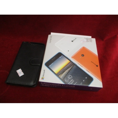 28 - LUMIA 640 MICROSOFT PHONE  UNUSED WITH BOX AND COVER...