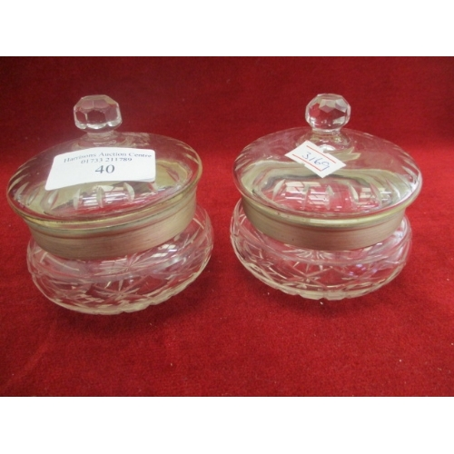 40 - LIDDED CUT GLASS BON BON DISHES WITH SILVER HALLMARKED COLLARS...