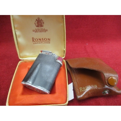 43 - A RONSON VARAFLAME LIGHTER IN BOX WITH LEATHER POUCH...