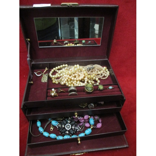 34 - BURGUNDY JEWELLERY BOX WITH 3 DRAWERS AND CONTENTS OF COSTUME JEWELLERY INCLUDING PEARLS AND RINGS...