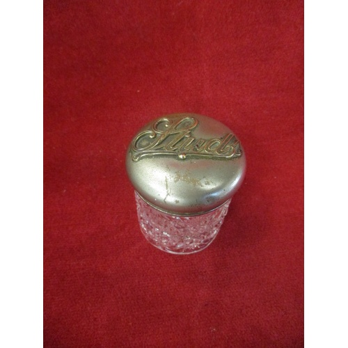 6 - CUTGLASS POT WITH SILVER PLATED LID WITH 'STUDS' WRITTEN ON IT...