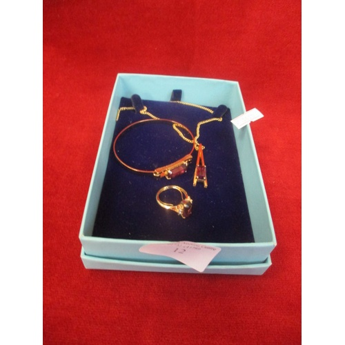 12 - GOLD COLOURED PENDANT ON CHAIN, BANGLE AND RING SET WITH PURPLE GLASS DETAIL IN PRESENTATION BOX...