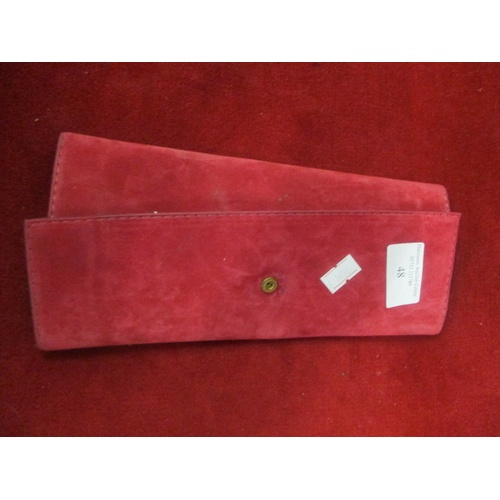 48 - RED JEWELLERY ROLL CONTAINING QUANTITY OF GOLD METAL NECKLACES AND EARRINGS...