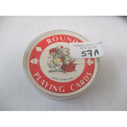 57A - A SET OF ROUND PLAYING CARDS...