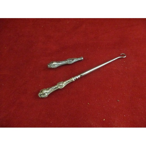 58 - SILVER HANDLED BUTTON HOOK AND A SILVER HALLMARKED BUTTON HOOK HANDLE ONLY...