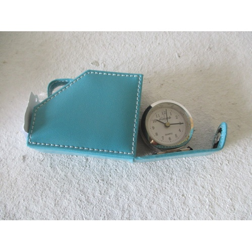 2 - QUARTZ TRAVEL ALARM  CLOCK IN A TURQUOISE CASE, NEW AND BOXED...