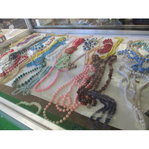 46 - LARGE QUANITY OF BEADED NECKLACES...