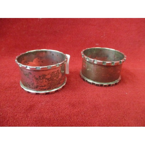 11 - 2 SILVER NAPKIN RINGS, BIRMINGHAM 1928 HENRY MORTON AND HENRY WILLIAMS AND SON LTD...