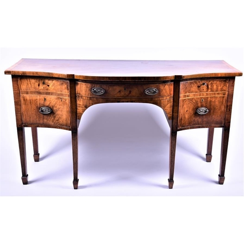 19 - A Georgian walnut veneered sideboard  the serpentine shaped top above a central drawer flanked with ...