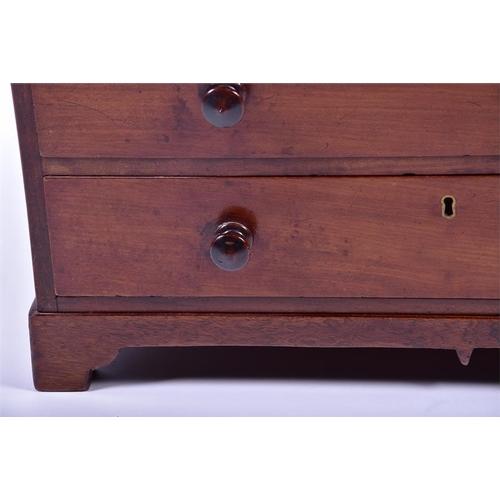 29 - A miniature mahogany chest  with three drawers on bracket feet, 54 cm x 32 cm x 37 cm....