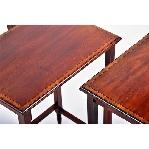 33 - An early 20th century English mahogany nest of tables  comprising three tables, each with satinwood ...