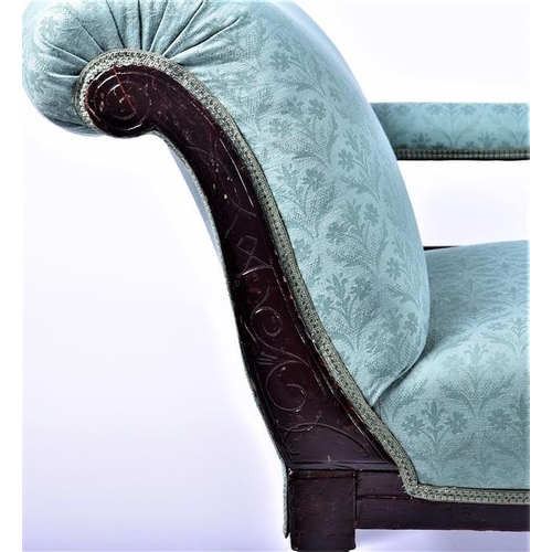 38 - A Victorian style mahogany chaise longue  upholstered in green foliate fabric, with scrolled end, an...