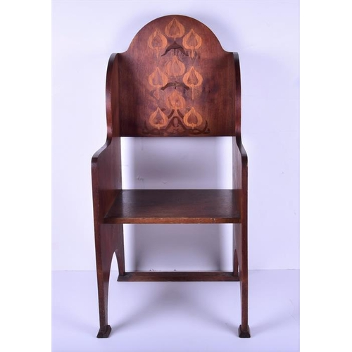 4 - An Edwardian Arts & Crafts mahogany inlaid chair  the back inlaid with flower heads, with solid shap...