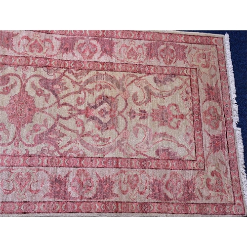 58 - A Ziegler runner with tasselled fringes  the decoration of stylised Art Nouveau flora within a repe...