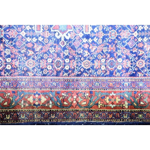 61 - A small Persian rug  the central field of detailed stylised foliate design with a repeating border o...
