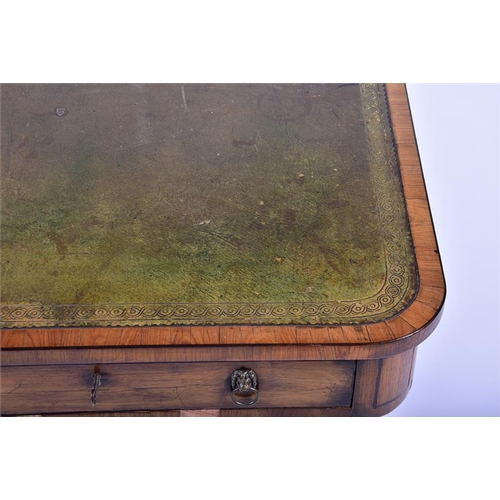 7 - A Regency two-drawer walnut veneered library table  of rectangular form, with a gilt-tooled scriber...