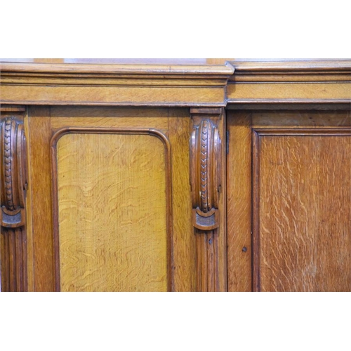 8 - A 19th century Continental oak mirror back sideboard  with arched top, the base with two central rec...